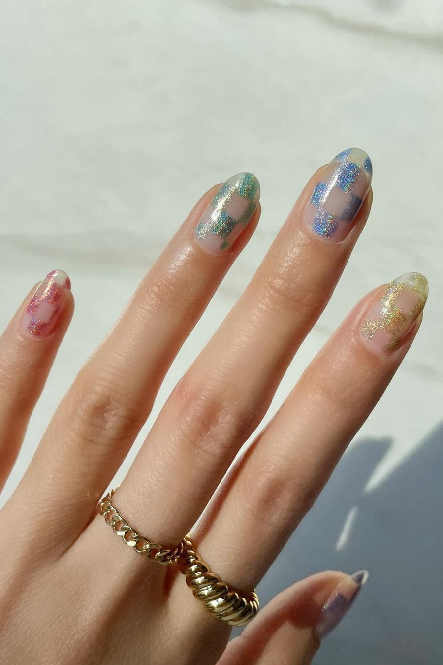 Shiny checkerboard oval nails