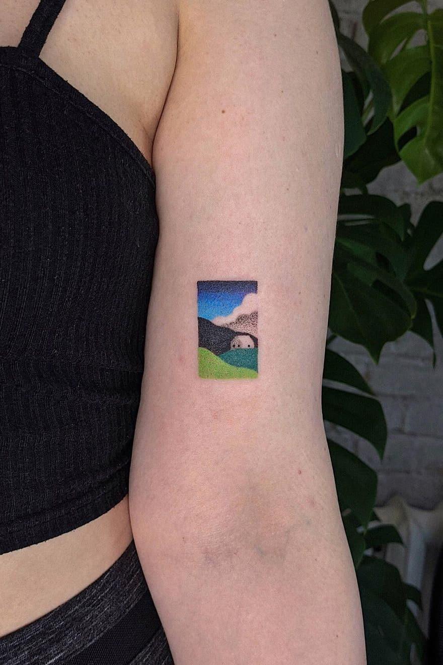 Tiny colorful landscape tattoo