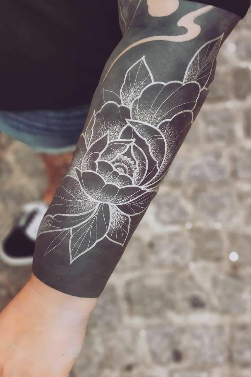 White sleeve tattoo