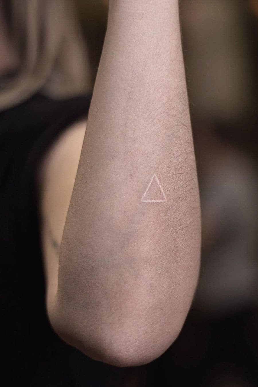 White triangle geometric tattoo