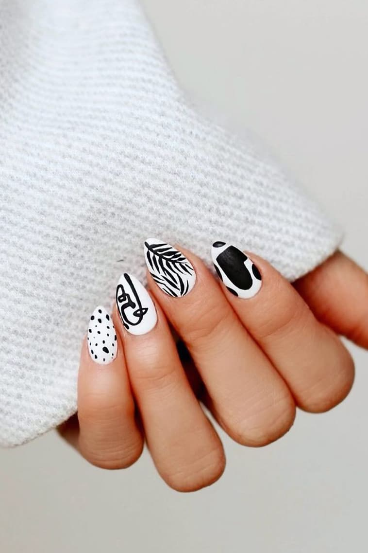 Black and white hand-painted art nails