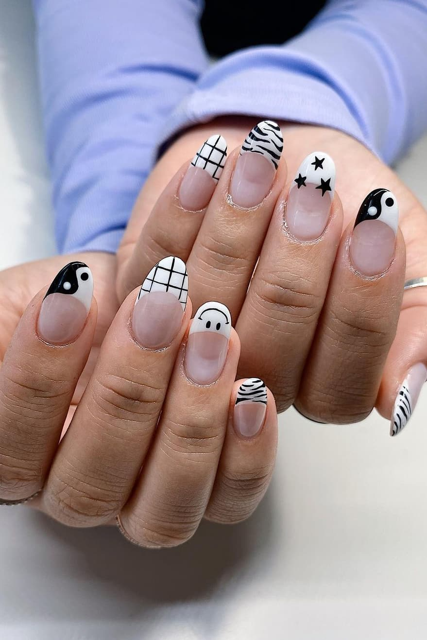 Black and white nails with mixed themes