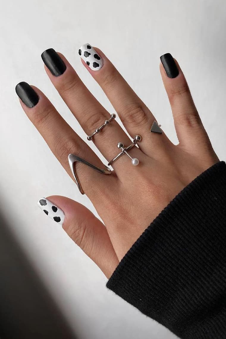 Cow print black and white nails
