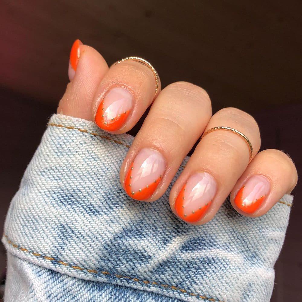 Delicate short orange nails