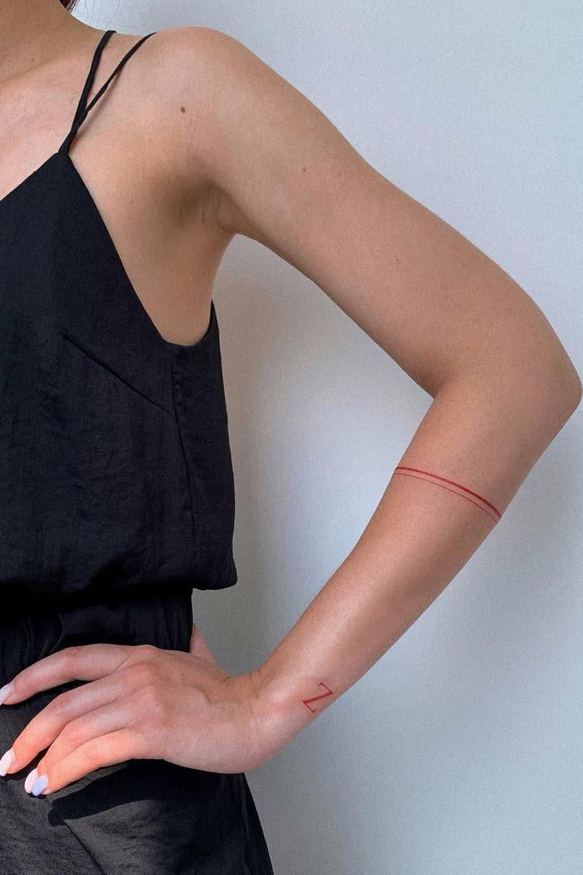 Minimalist red tattoo