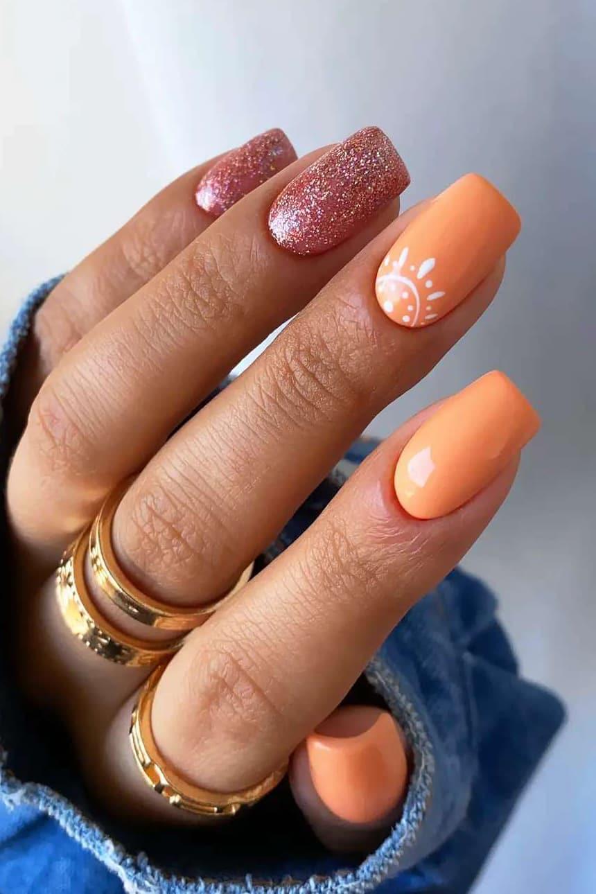 Orange and rose gold nails