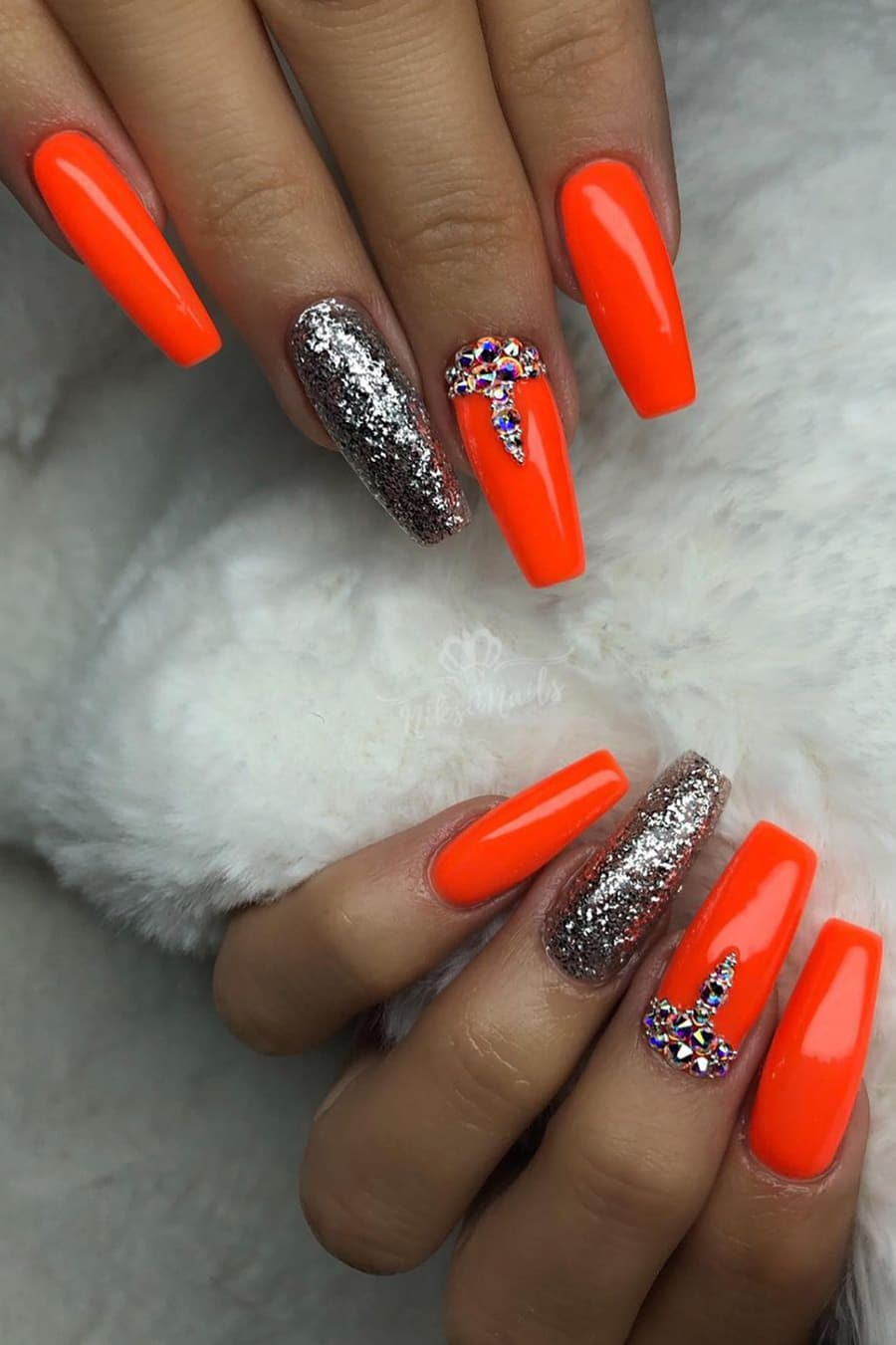 Orange and silver nails