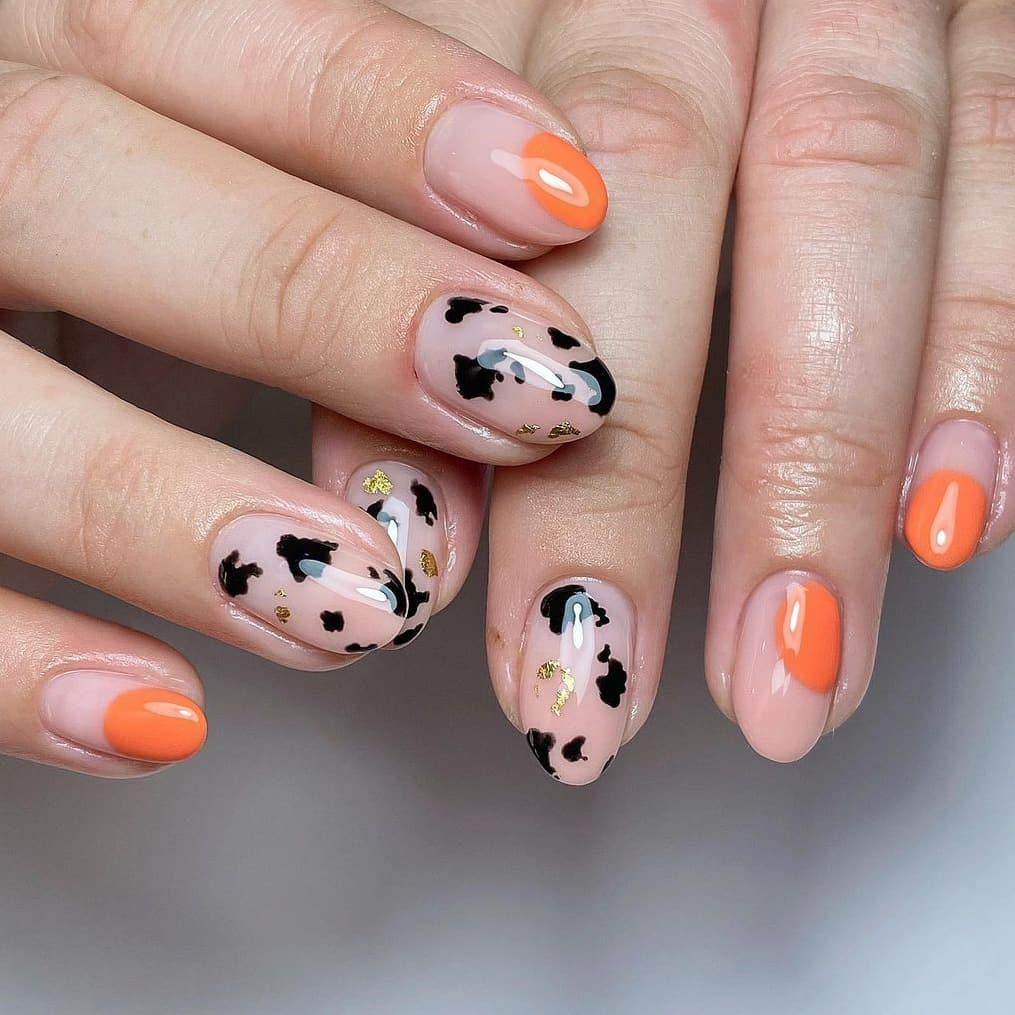 Orange cow print nails