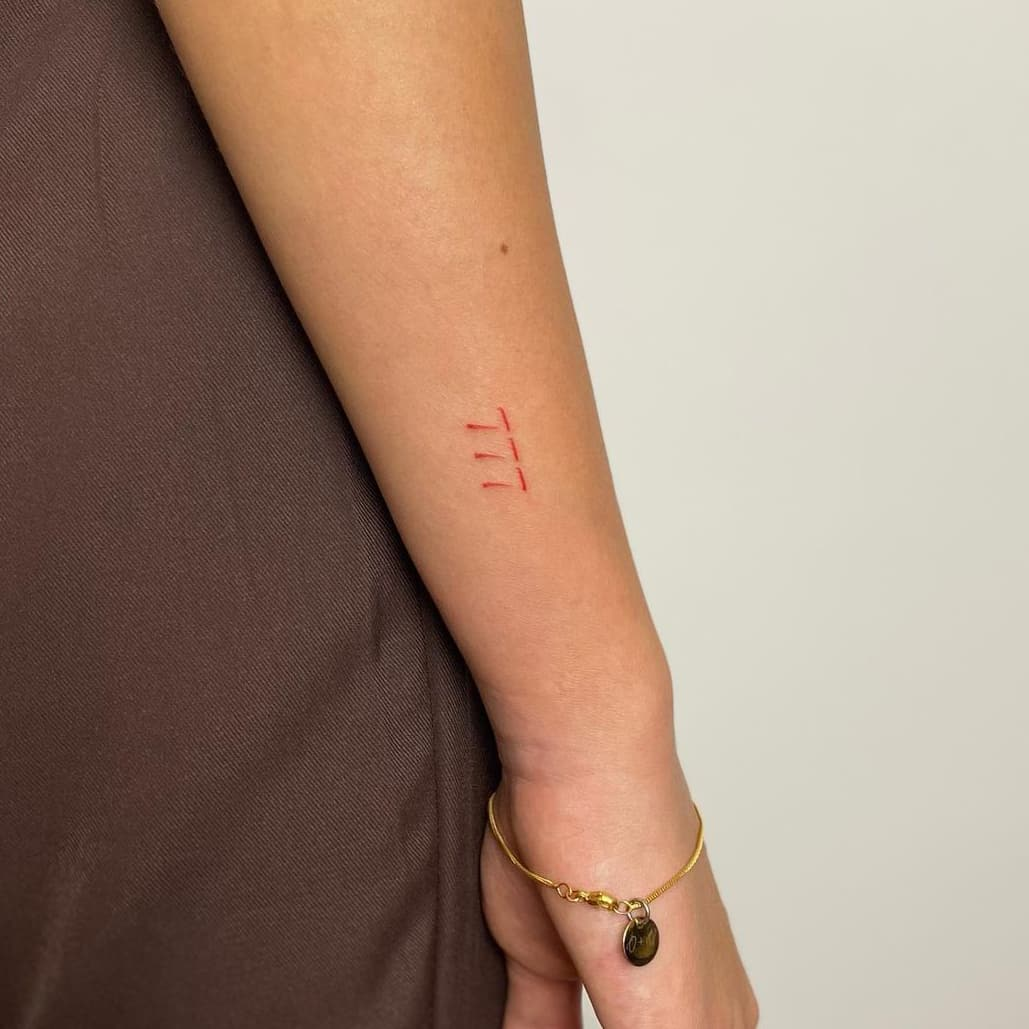Red Number Tattoo