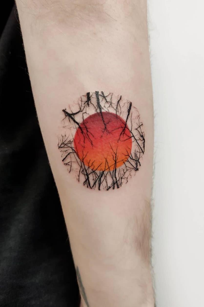 Red sun tattoo
