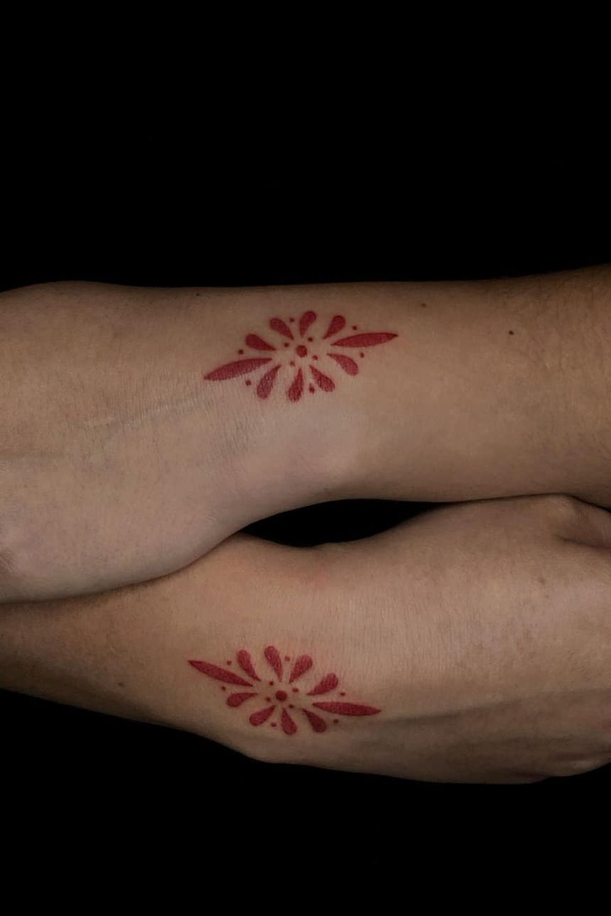 Red tattoo on hand