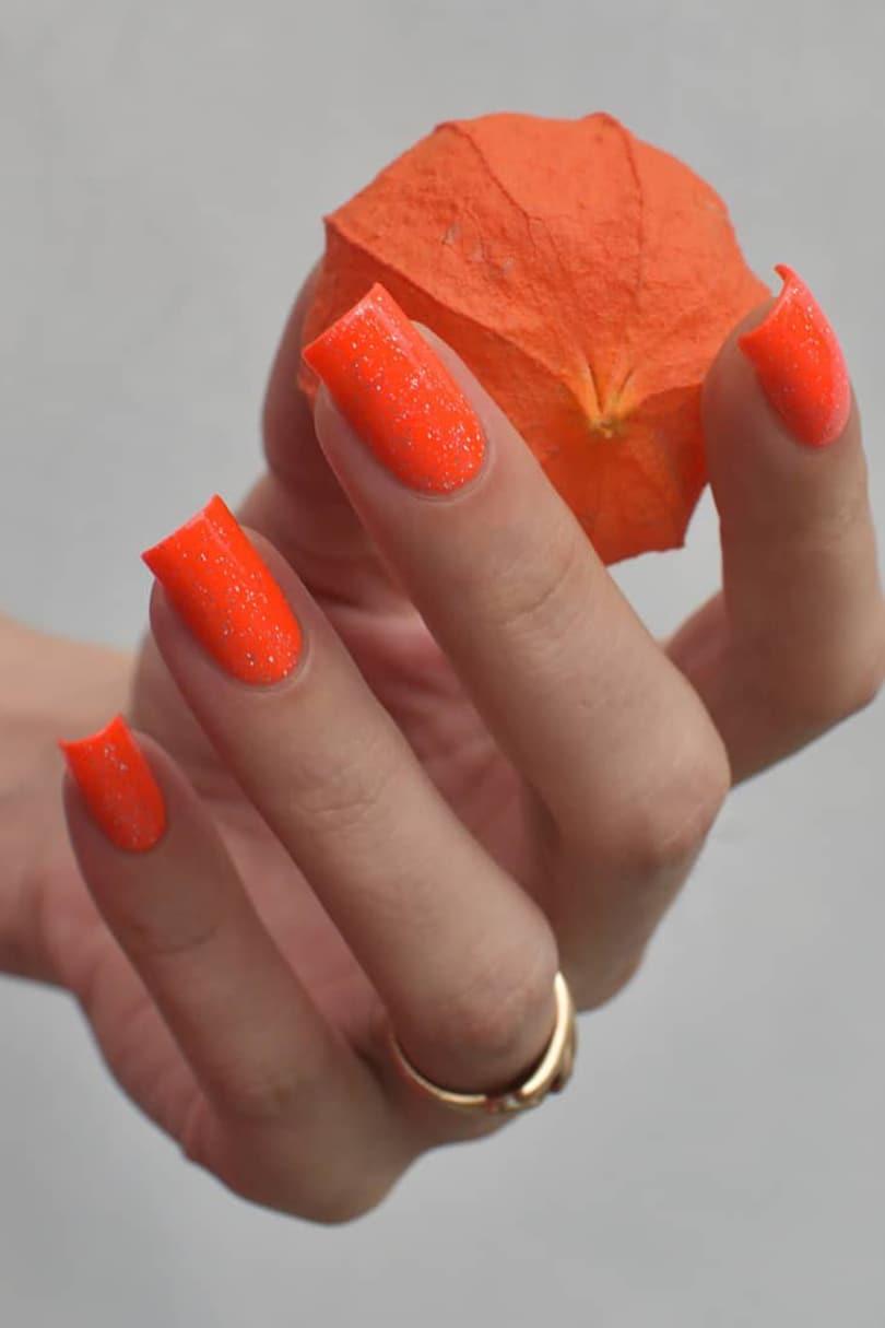 Shining orange coffin nails