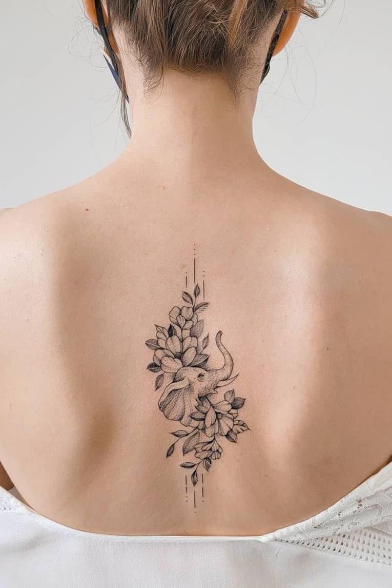 Simple flower elephant tattoo