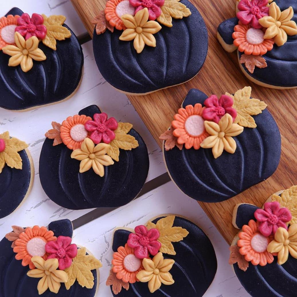 Black pumpkin cookies with flowers