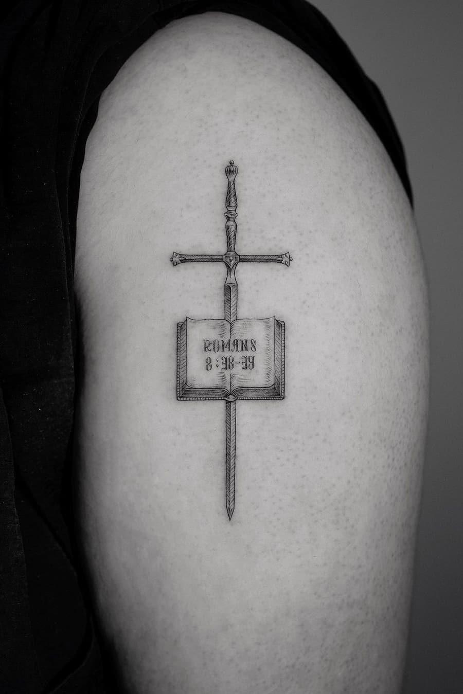 Book sword tattoo