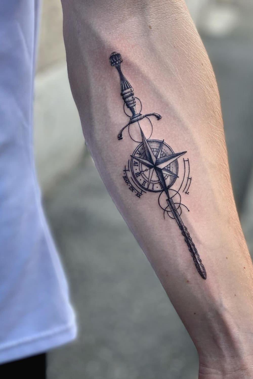 Compass sword tattoo