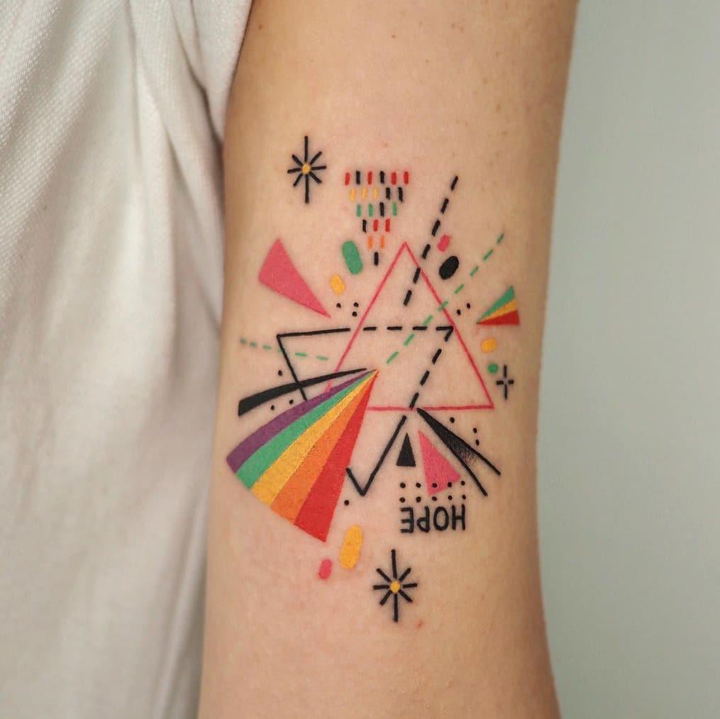 Geometric rainbow tattoo