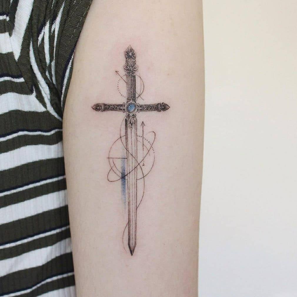 Geometric sword tattoo