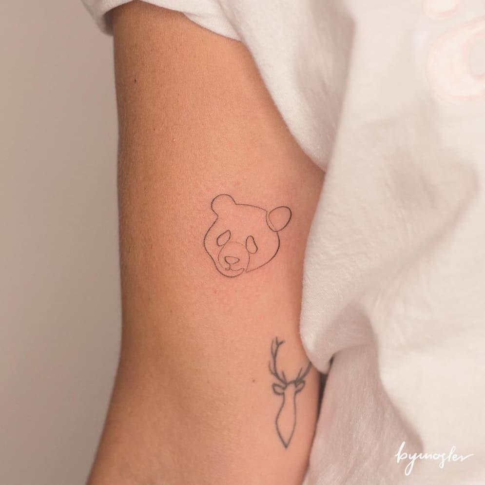 Minimalist panda tattoo