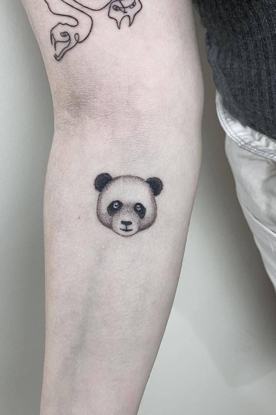 Panda face tattoo