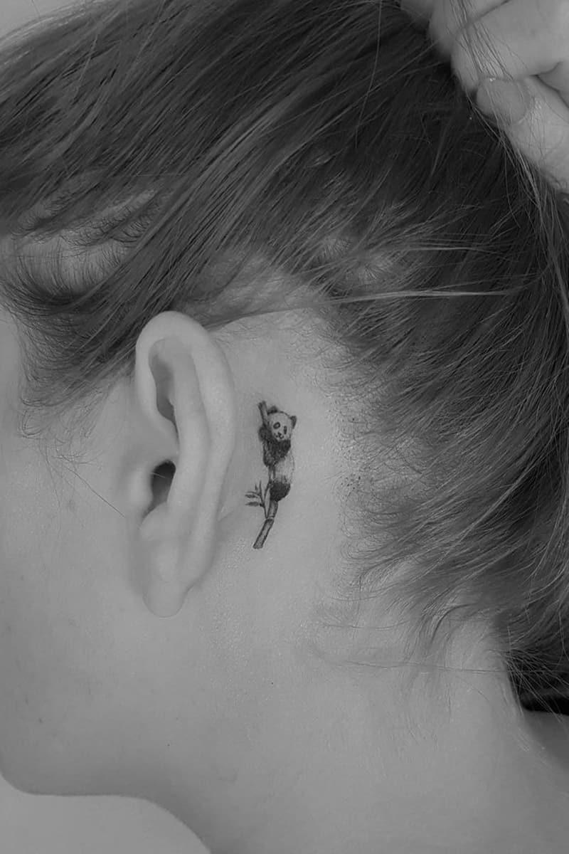 Panda tattoo behind the ear