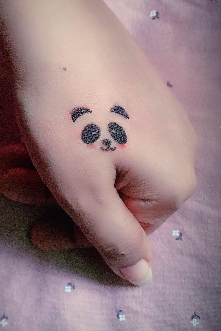 Panda tattoo on hand