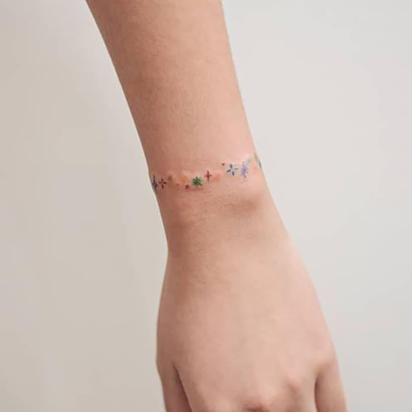 Rainbow bracelet tattoo
