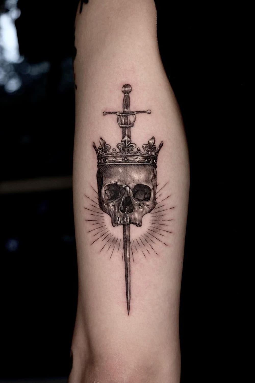 Skull sword tattoo