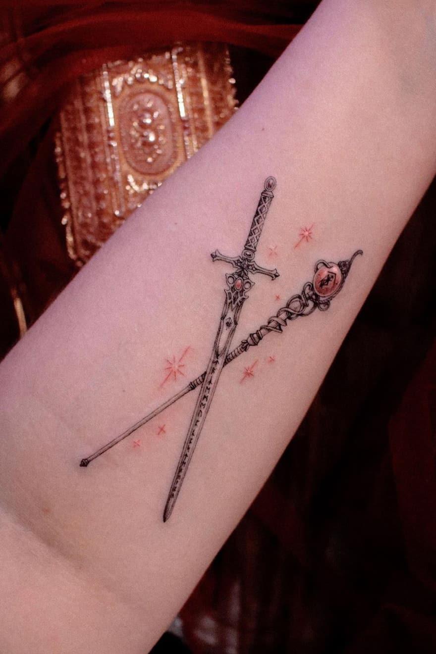 Staff and sword tattoo