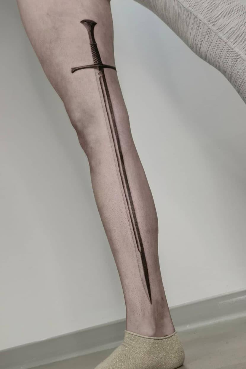 Sword tattoo on the leg