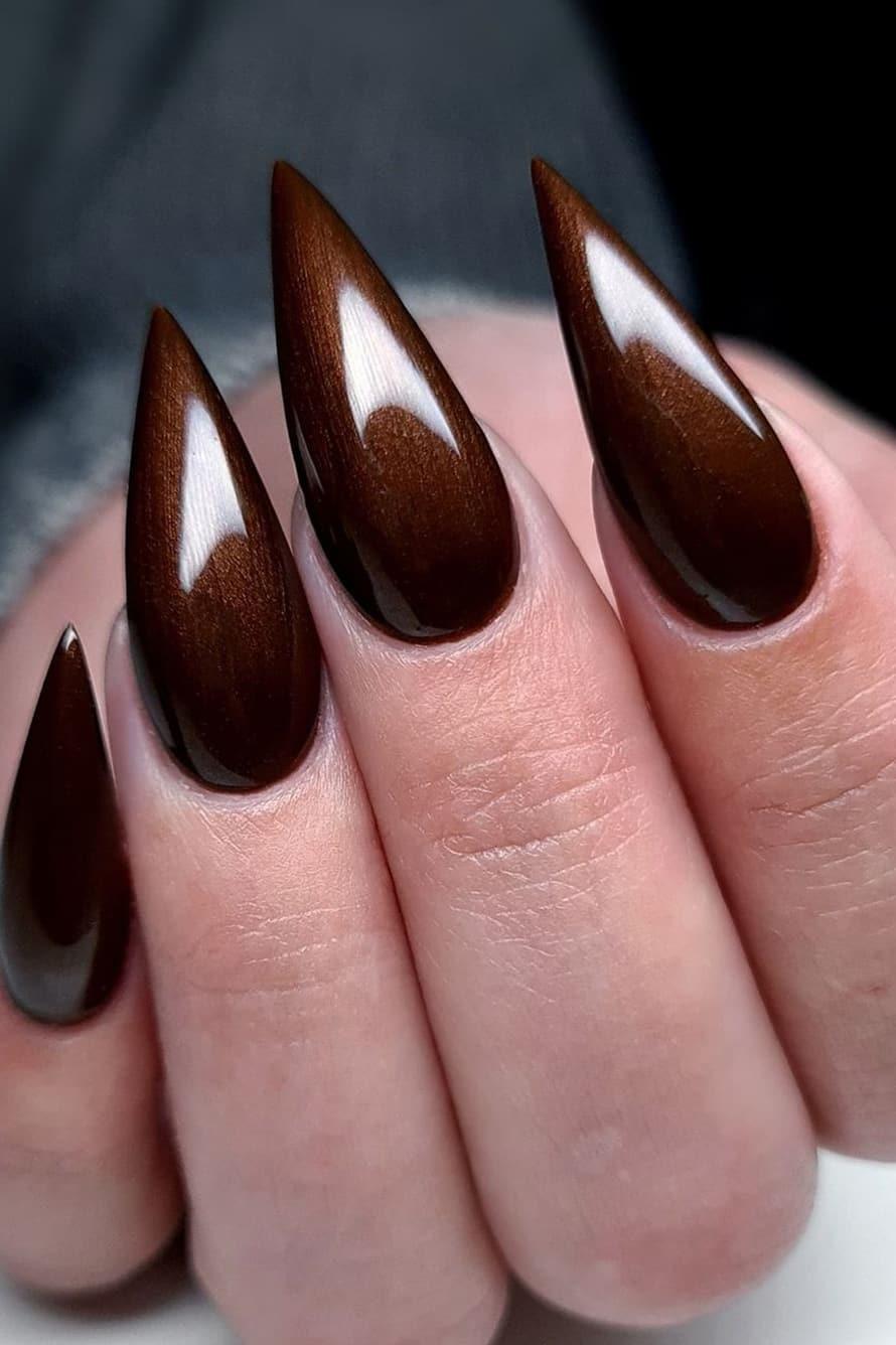 Stiletto brown nails